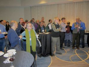 Photo from the Reviewer Reception at JMM 2019 in Baltimore. Visible: mathematicians, librarians, and publishers