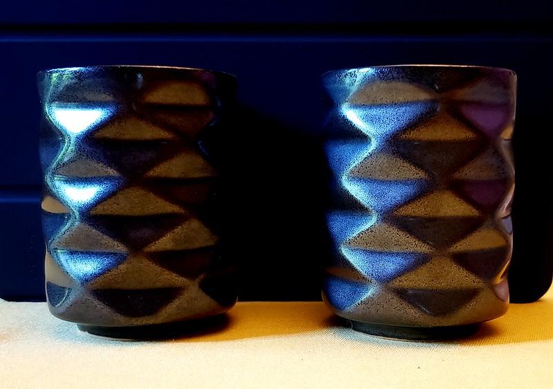 Ceramic mugs in the shape of a Yoshimura crease pattern