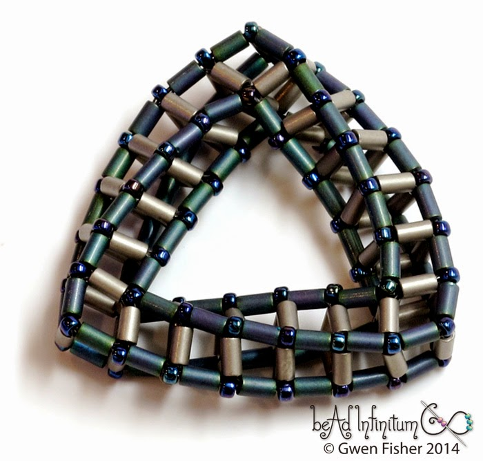 "A beaded ""highly unlikely triangle."" Image copyright Gwen Fisher. Used with permission."