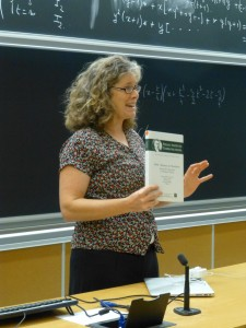 Kristin Lauter, showing the group the first WIN proceedings volume.
