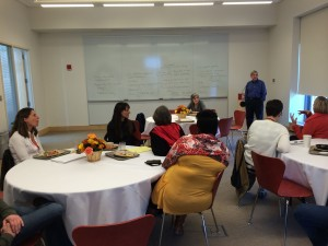Mike Starbird (standing) teaches Bates faculty an important lesson.