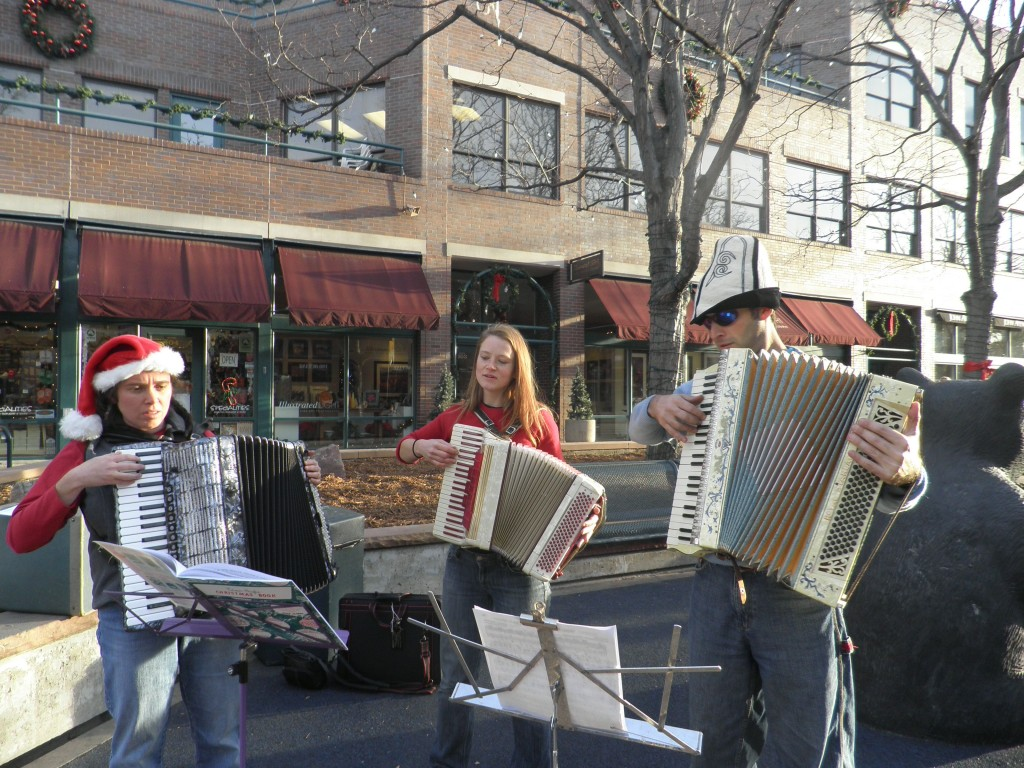 This photo illustrates growth mindset overcoming serious music anxiety.  It also illustrates three mathematicians (Amy Ksir, me, and Renzo Cavalieri) playing Christmas Carols on accordions in public.  I know, you wish you were there, or that I at least had sound for you...