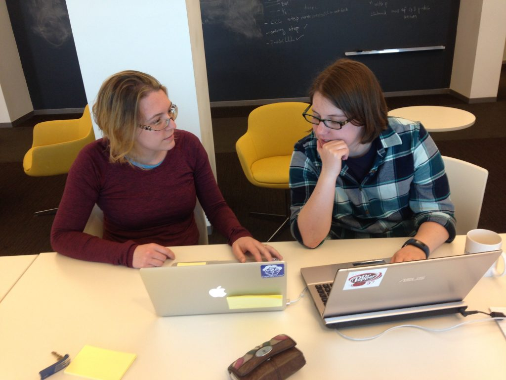 Christelle Vincent and Mckenzie West fixing something major during a collaboration at ICERM.